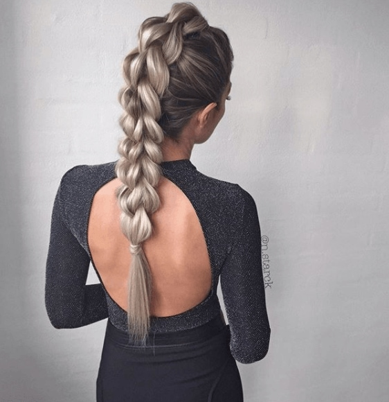 back view of a woman with long blonde braided hair - faux hawk braid
