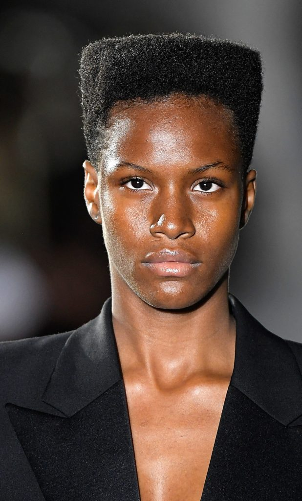 model on the Saint Laurent ss17 runway with a Grace Jones-inspired afro hairstyle wearing all black