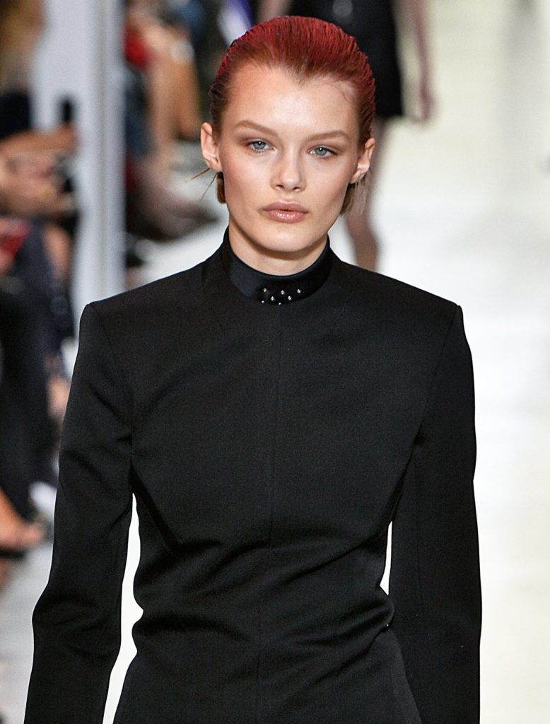 model on the Paco Rabanne SS17 runway wearing all black with short brown hair slicked back with a red colour spray coloured