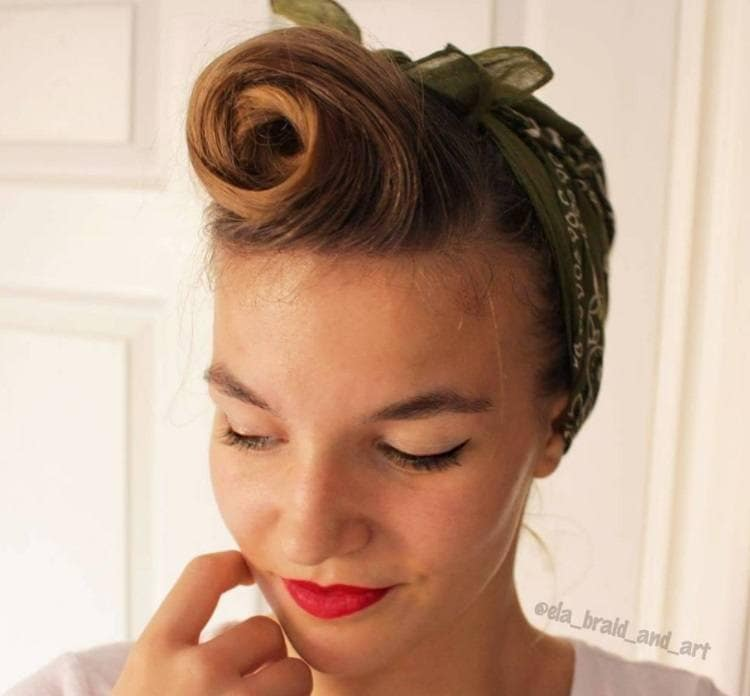 updos for short hair: woman with long pixie styled into a vintage rolled updo