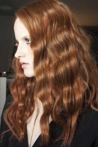 Hair straightener: wavy red hair