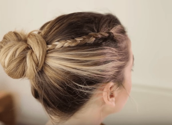 side view of zoella wearing a braided bun in her blonde and brown hair