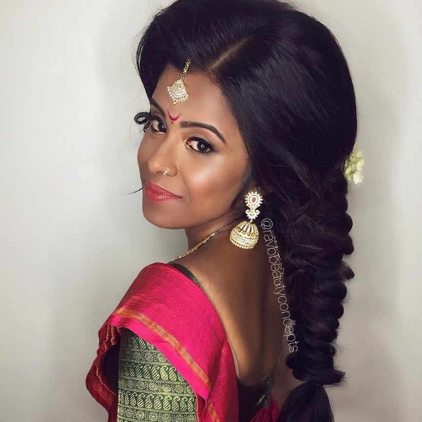 Indian Wedding Hairstyles: Close Up Shot Of Bride With Voluminous Dark Hair  Fashioned Into A
