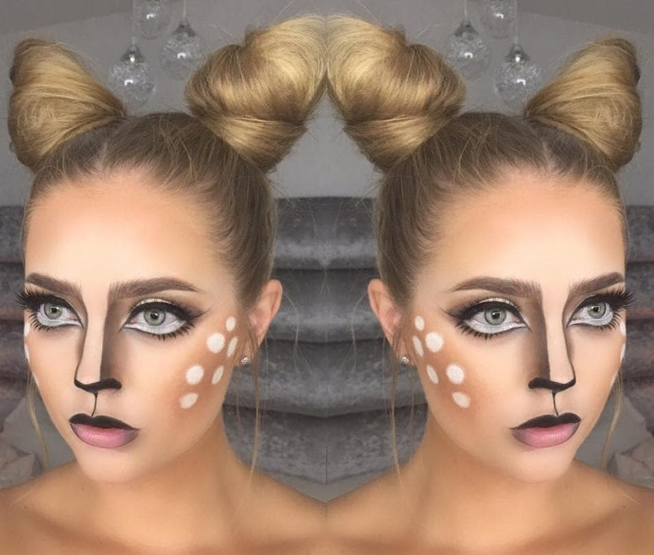 woman with face painted as a deer with two top knot hair buns as ears