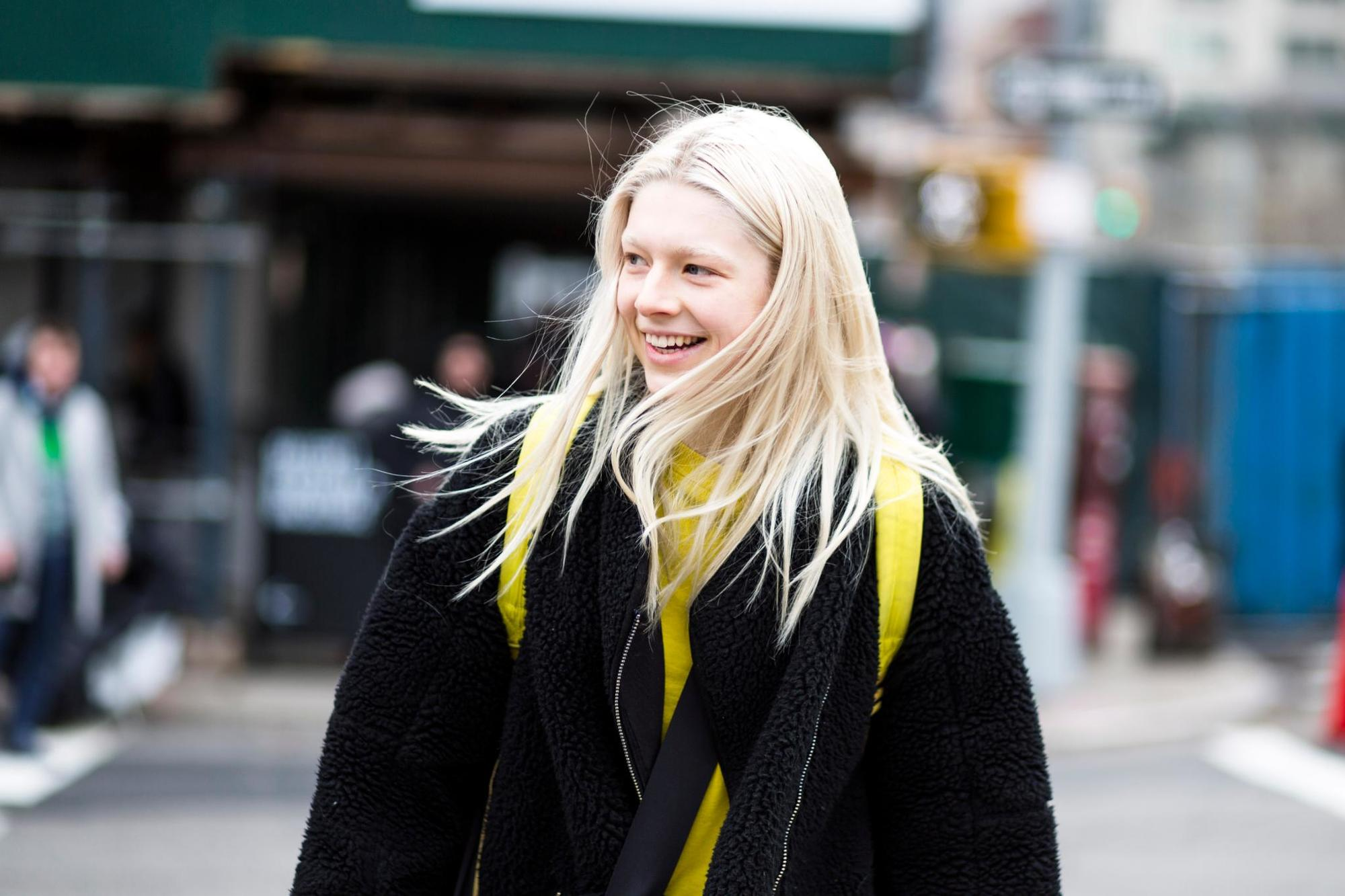 Purple shampoo: Close-up street style shot of a woman with baby blonde long hair