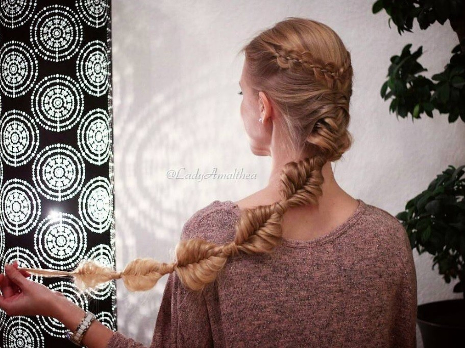 back view of a woman with long bronde hair in a braided bubble ponytail