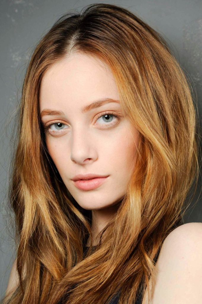 Red Hair Model With Strawberry Blonde Copper Highlights Styled A Tousled Wave