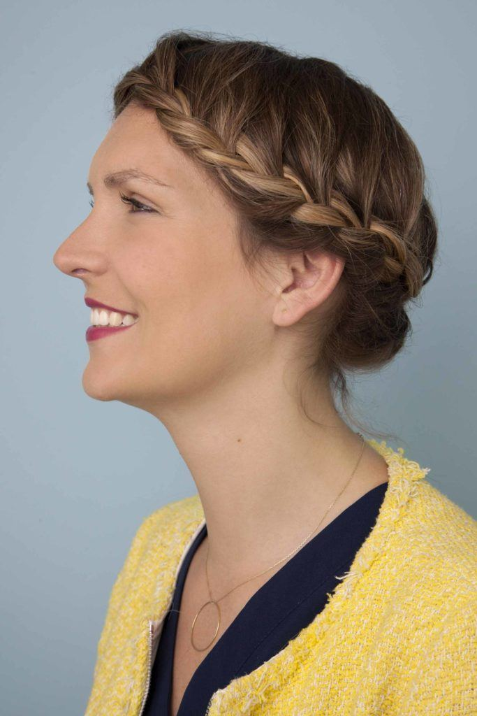 side view of a woman with bronde hair in a crown braid - going out hairstyles