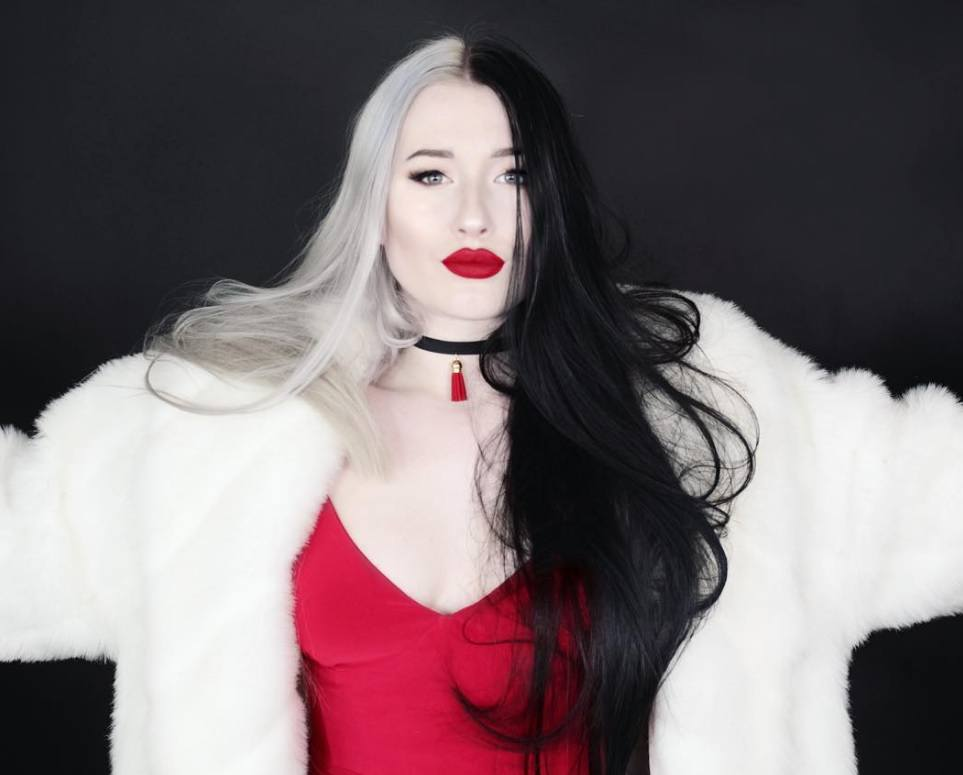 woman dressed in a Cruella de Vil costume with white and black hairstyle