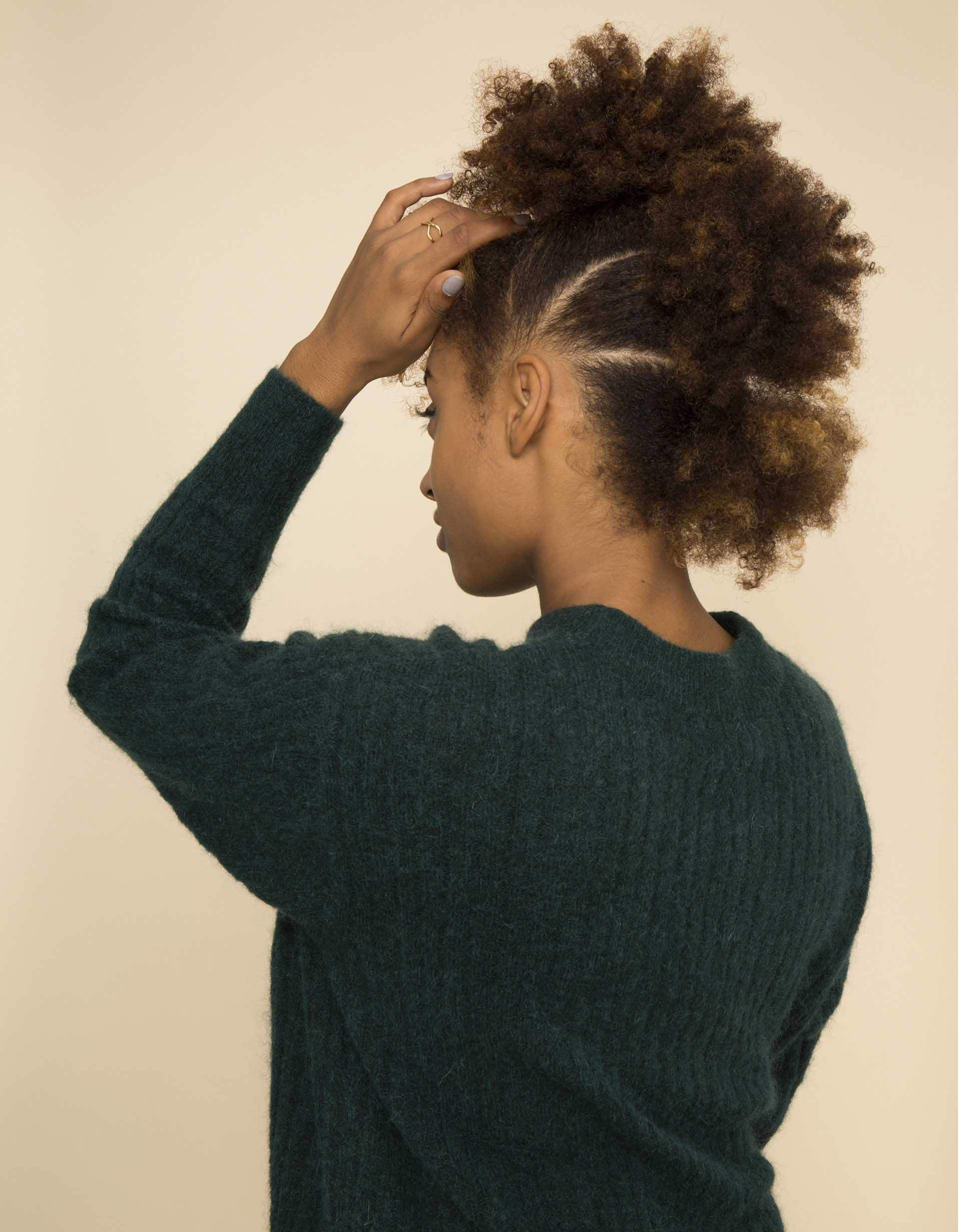 Easy updos - black model with an afro 'frohawk against a pink backdrop