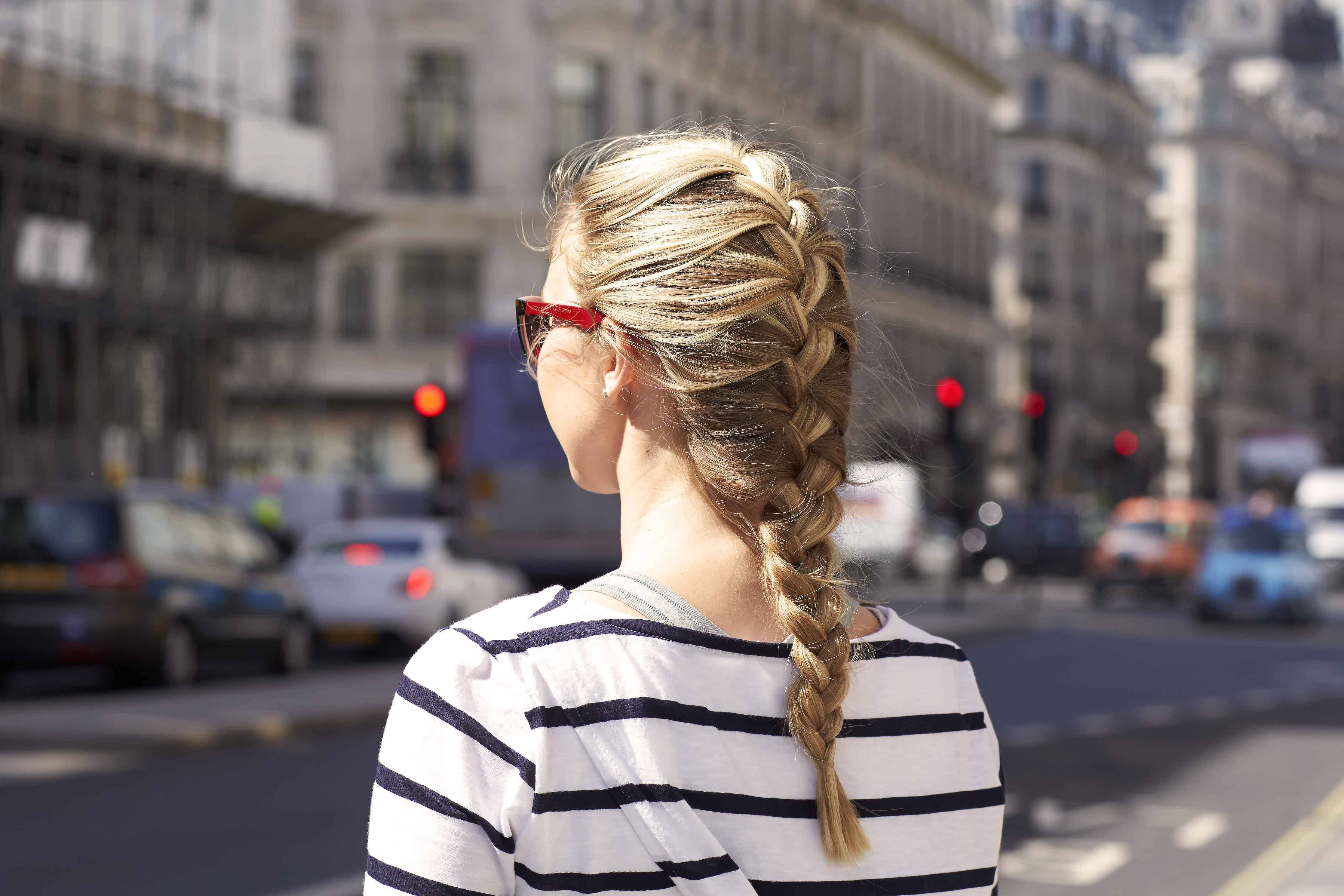The Back View Of A Blonde With An Easy French Braid