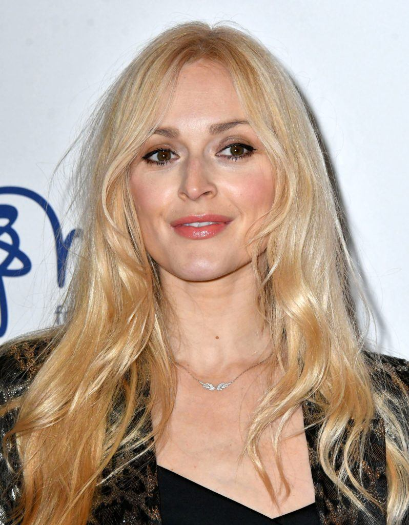 Fearne Cotton with long fine golden blonde hair with face-framing layers, wearing suit jacket on the red carpet