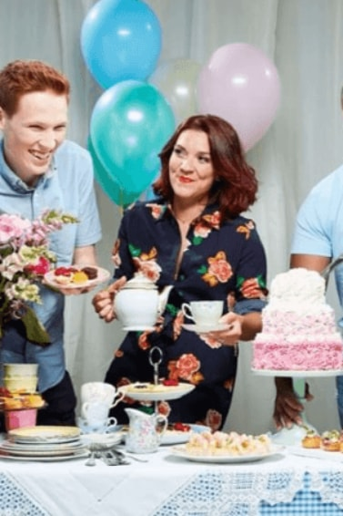 Jane Beedle, Candice Brown and other Great British Bake Off contestants sampling cake son a table