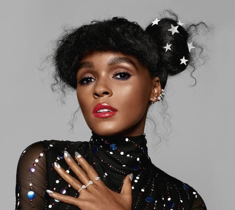 shot of janelle monae with hair accessories in her hairstyle posing