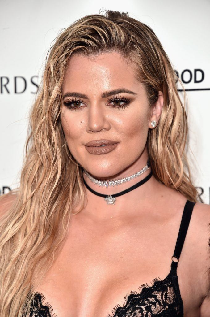 Khloe Kardashian rocks wet-look long wavy hair and slays ...
