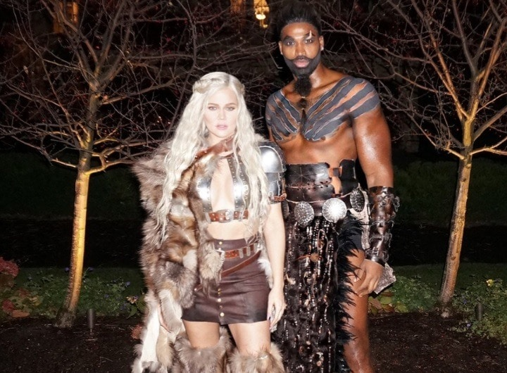 shot of khloe kardashian with half up half down braided hairstyle, dressed as khaleesi from GOT with khal drogo