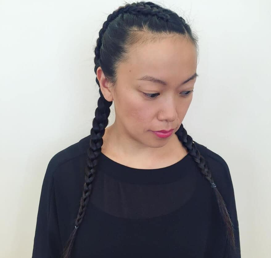 asian woman with a neat dutch braid in her long hair