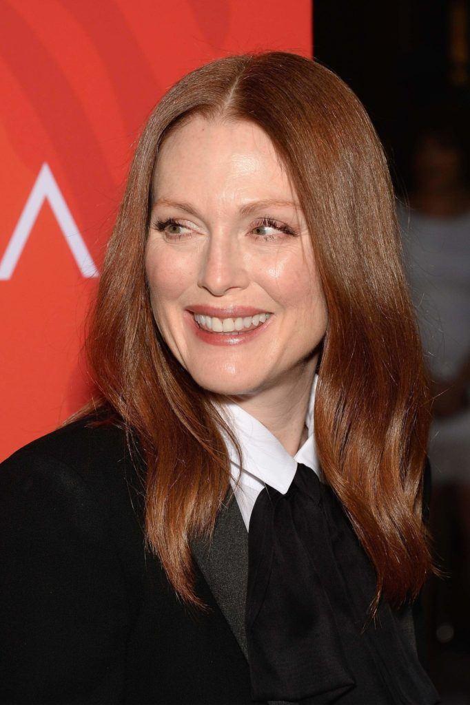 julianne moore ronze brown red hair medium-length wearing white shirt and black blazer