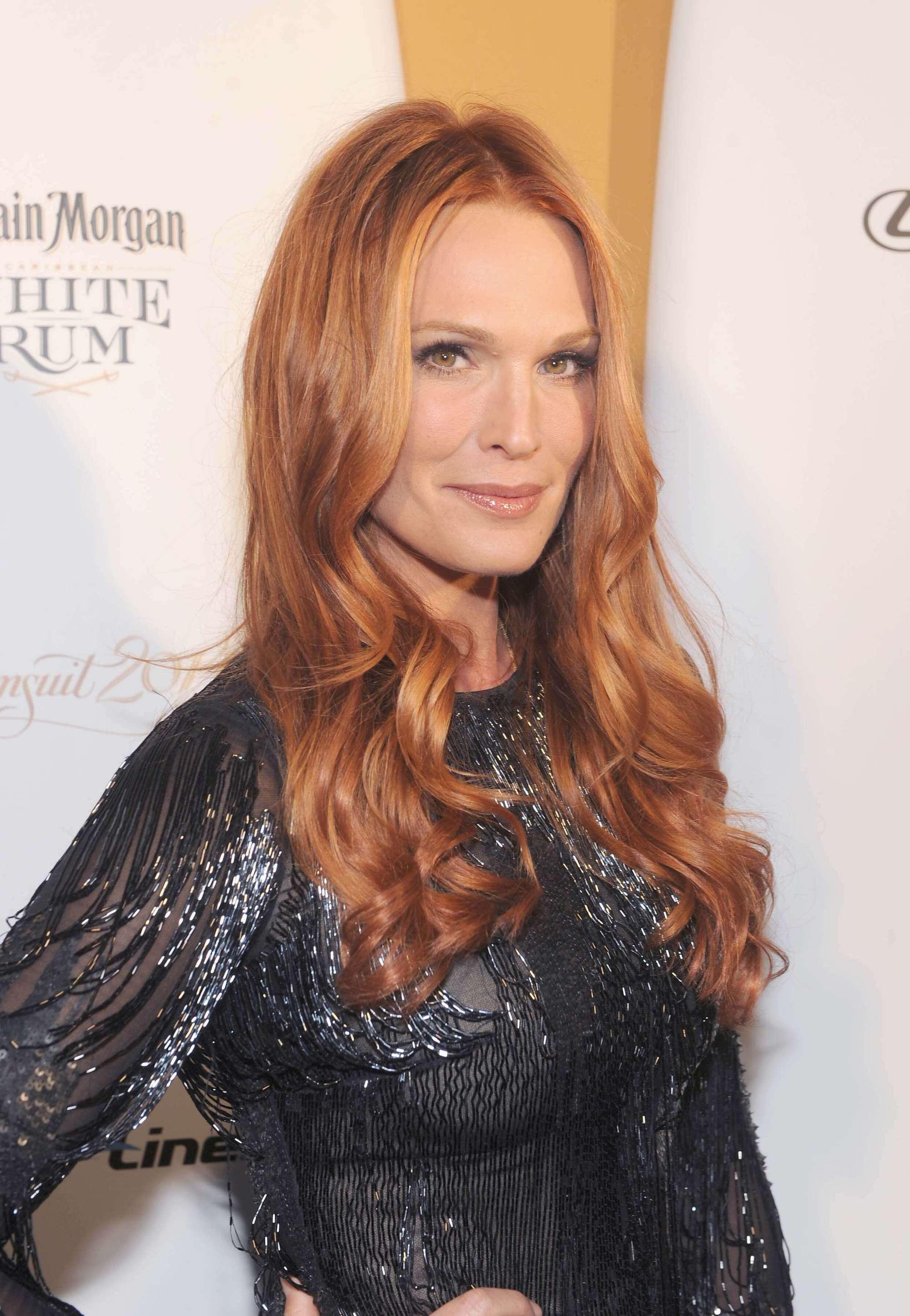 molly sims long golden copper wavy hair wearing black dress