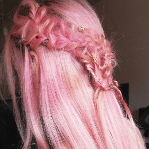 Medieval hairstyles: Back of a woman's pink hair with braids and half her hair down