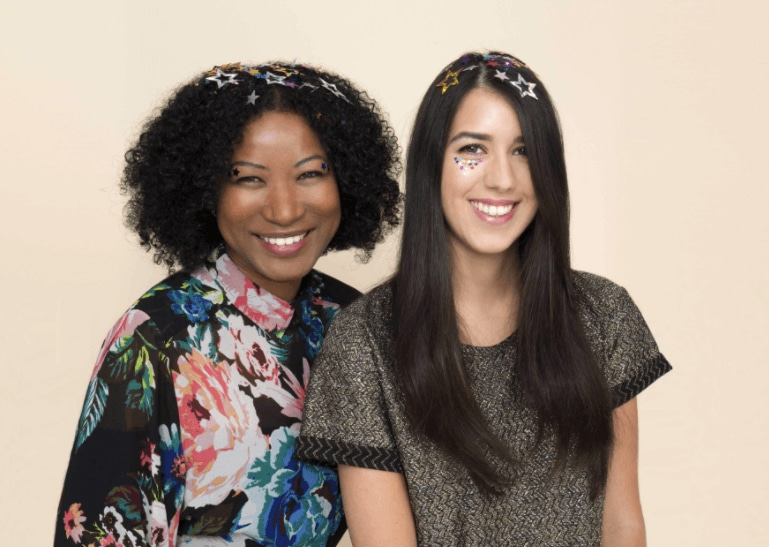 image of two woman with their hair down with glitter in their hair - going out hairstyles