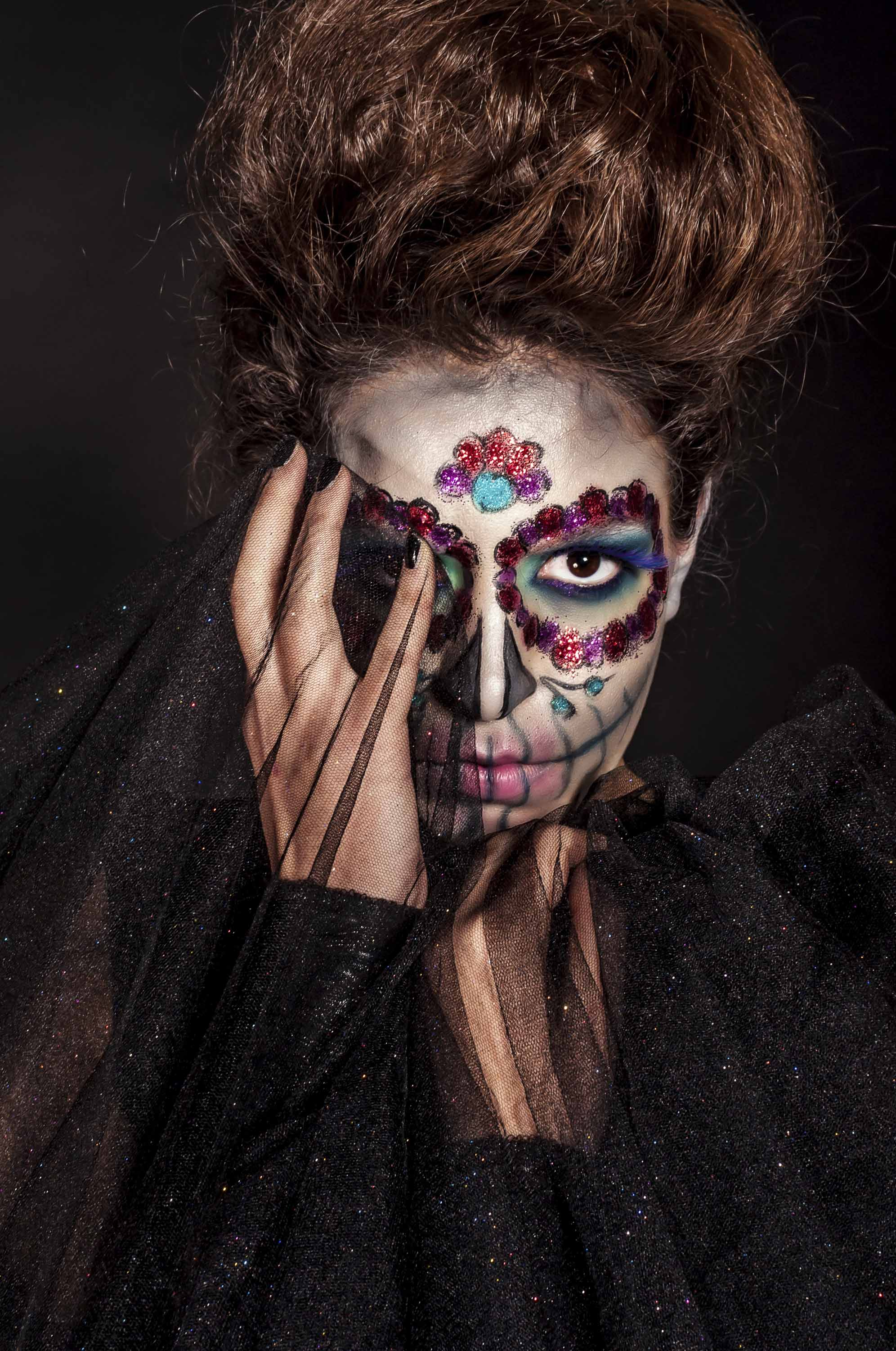 woman with sugar skull make up and hair in a large bouffant