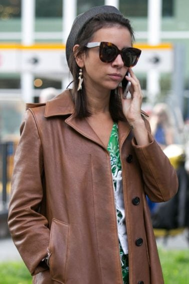 How to style short hair: Miroslava Duma accessorising short hair with a hat at Fashion Week