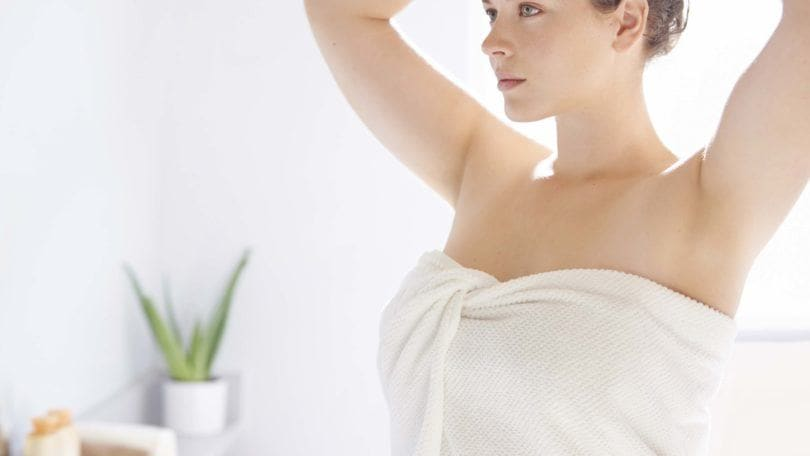 Not washing your hair: All Things Hair - IMAGE - woman washing her