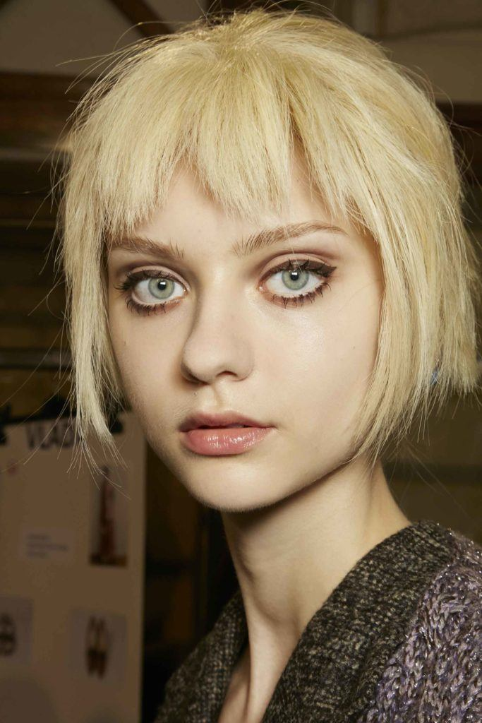 Close Up Shot Of A Model With Flaxen Blonde Hair Cut Into Choppy Bob And