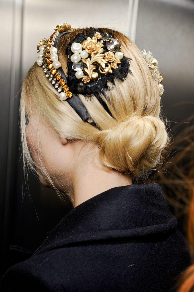 updos for long hair: model with low bun with floral