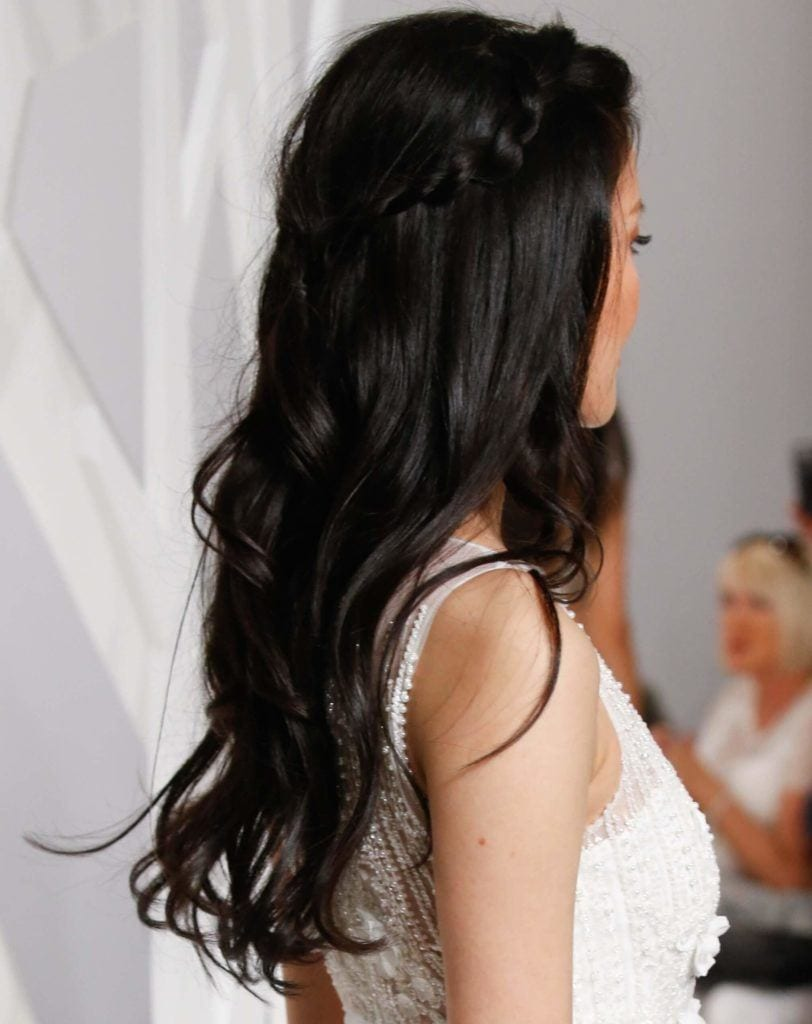 quick party hairstyles: back view of a woman's hair with long dark waves