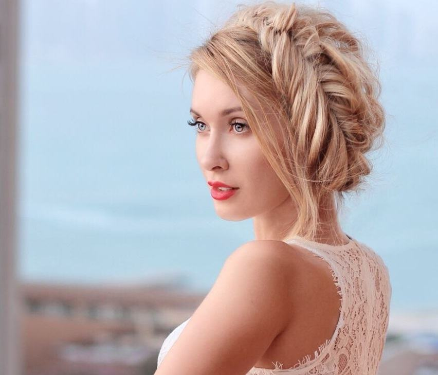 updos for long hair: model with fishtail braided halo hairstyle