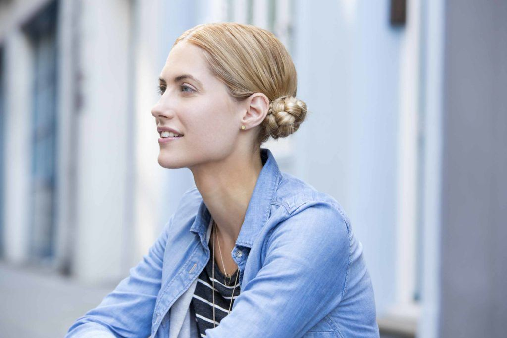 blonde model with braided space buns