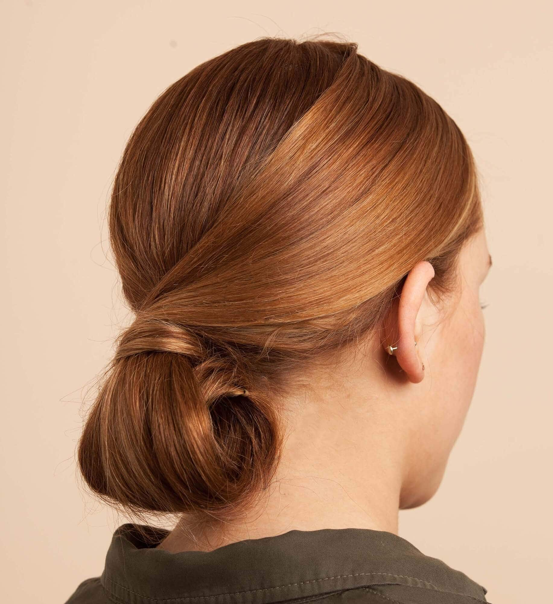Back view of a woman's hair with a smooth and sleek chignon