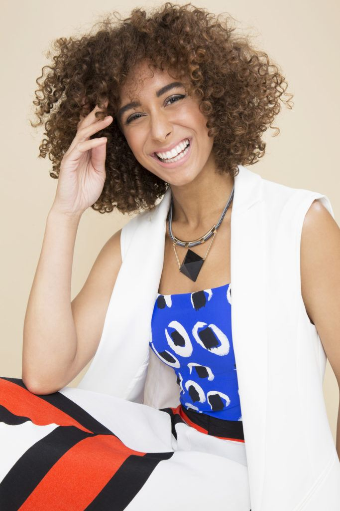 woman laughing with curly afro hair in a medium brown colour