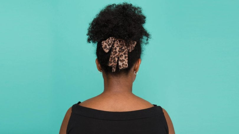 Curly hair updo with bow: All Things Hair - IMAGE - The final look