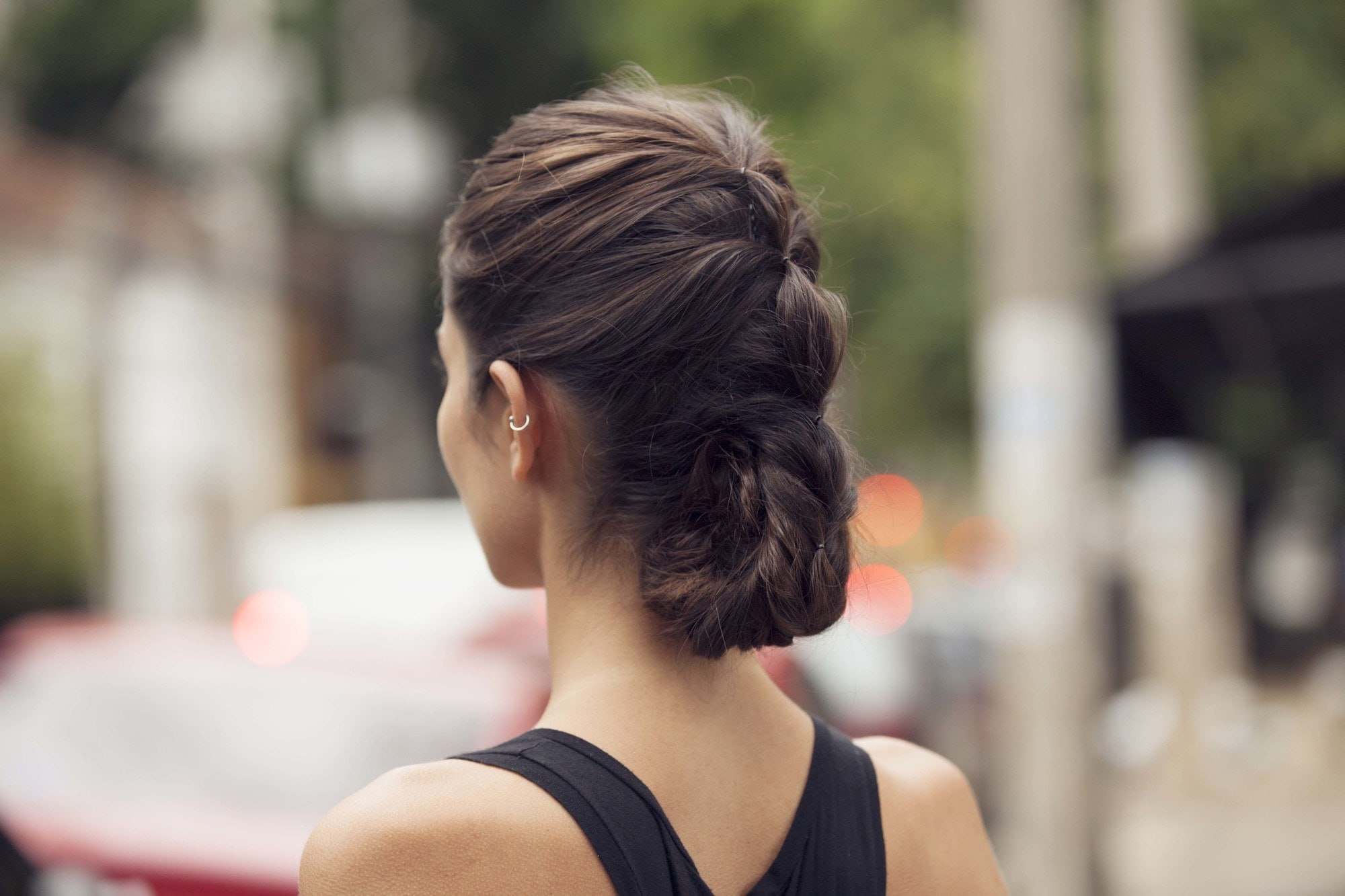 easy updos for long hair: model with fake braid roll hairstyle backshot