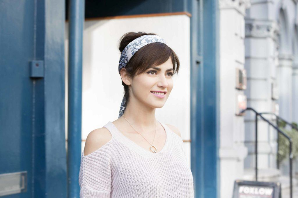 party hairstyles: front view of a woman with faux bangs, headband and fringe updo