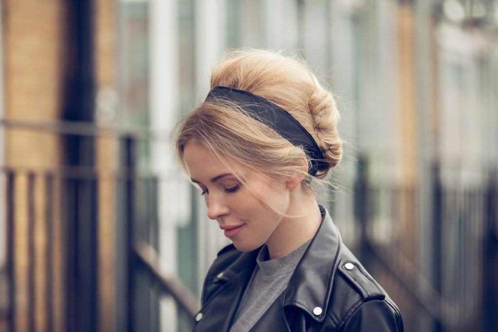 easy updos for long hair; model with long hair styled into a french twist hairstyle