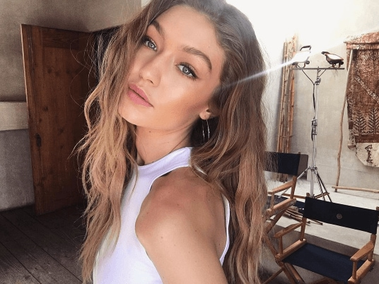 selfie of model gigi hadid with blonde bronde hair with darker hair shadowing at her roots