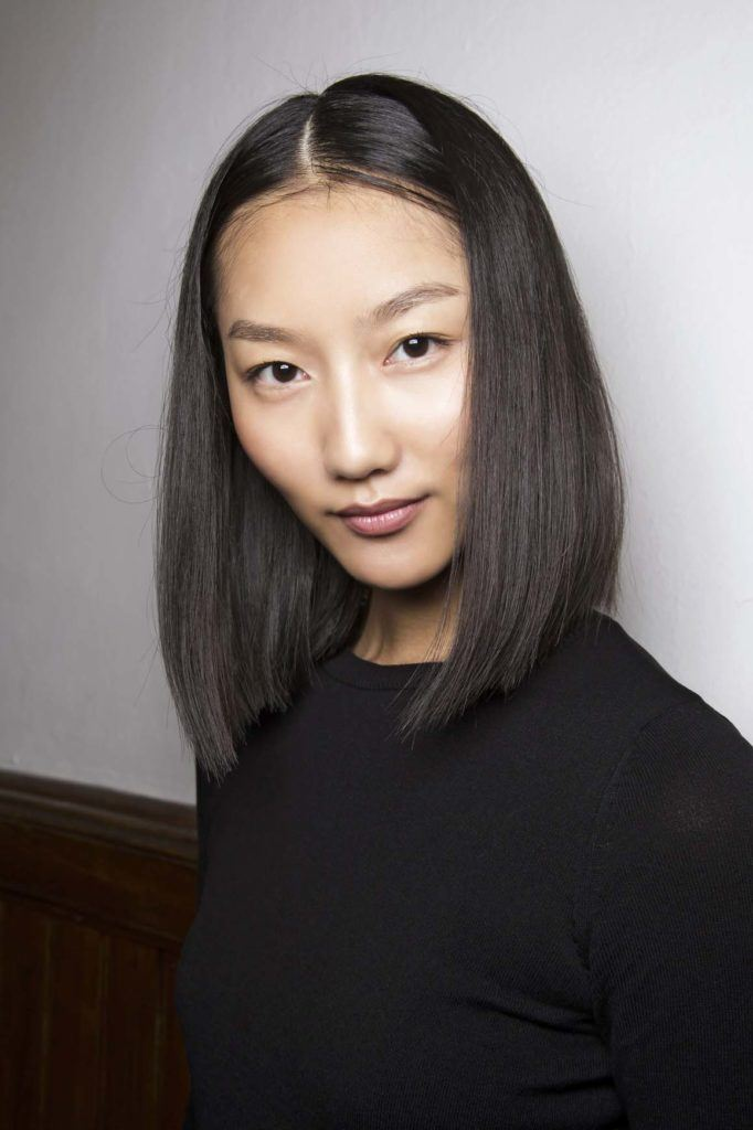 Asian model with straight graduated bob haircuts with centre part