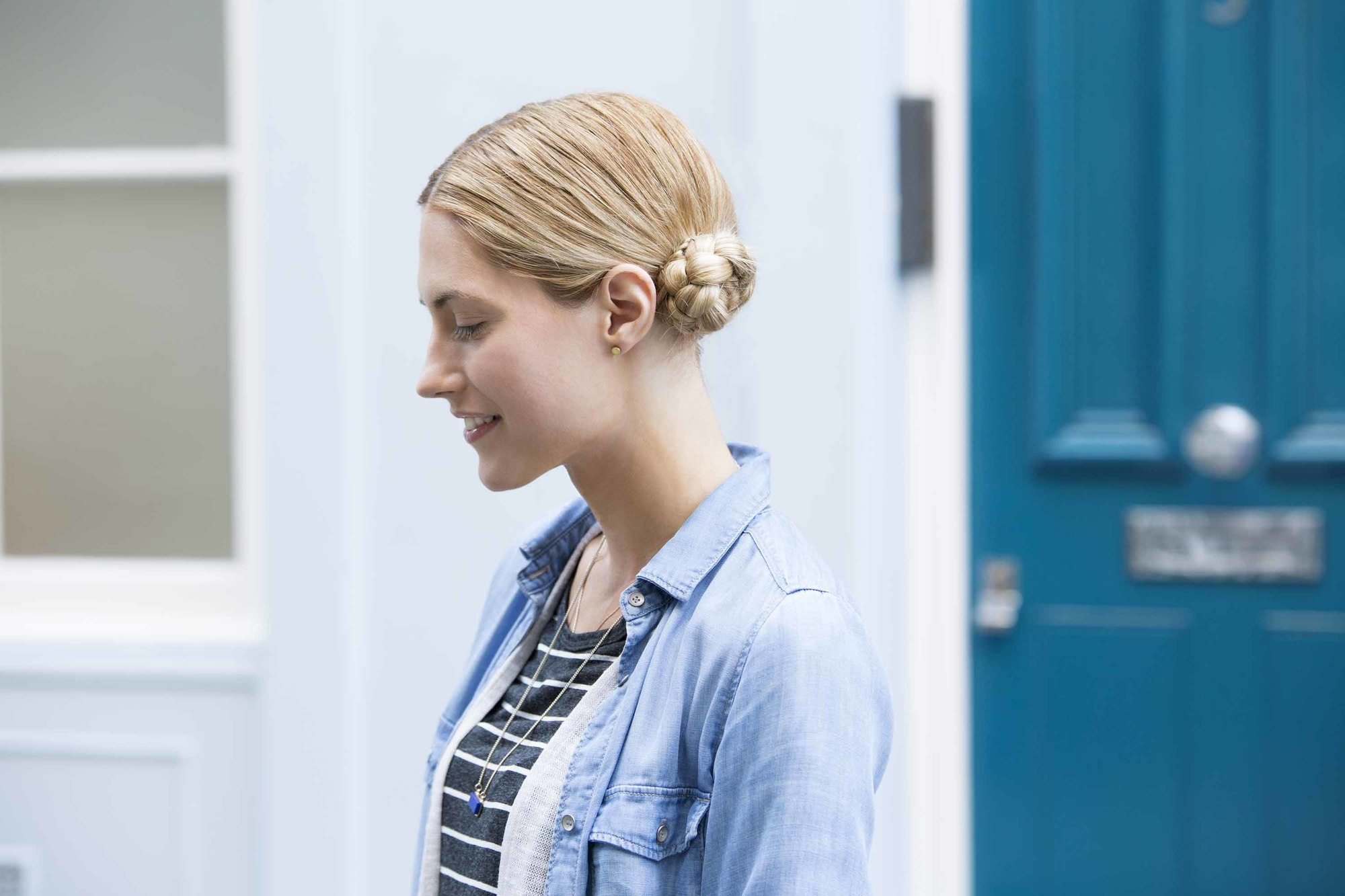 up hairstyles for long hair: streetstyle shot of model with braided low space buns