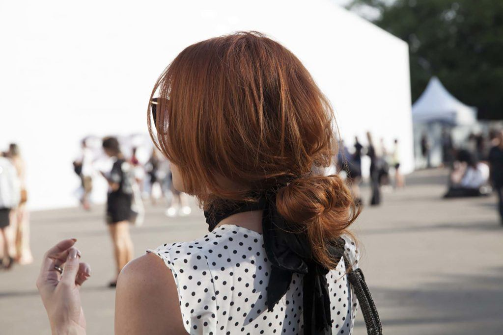 easy updos for long hair: model with low messy bun hairstyle