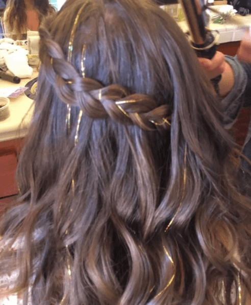 Back Of A Womans Head With Brown Hair In Braid Gold Tinsel