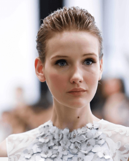 evening hairstyles: image of a model with short slicked back hair