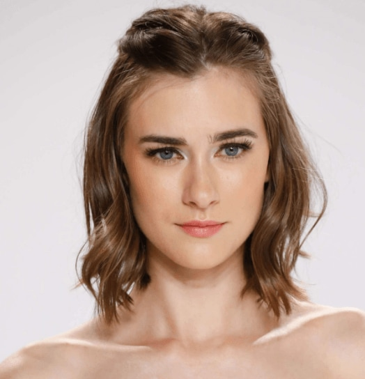 hairstyles for a party: image of a woman with brown wavy hair pinned back at the sides