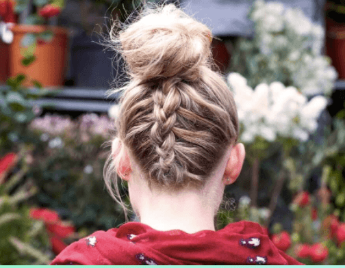 party hairstyles: back view of a woman's blonde hair with an upside down braided bun