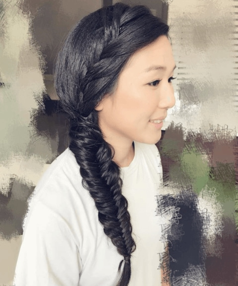 Fishtail braids:: Woman with long dark hair in a fishtail hairstyle