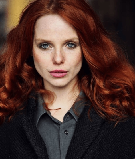 front view image of a model with dark red fiery hair