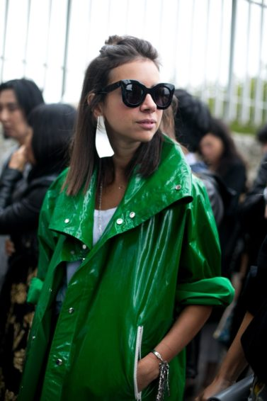 blunt haircut: women in green coat on the streets of Paris